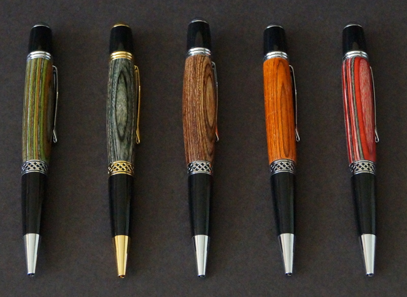 a selection of pens turned from different colors of WebbWood